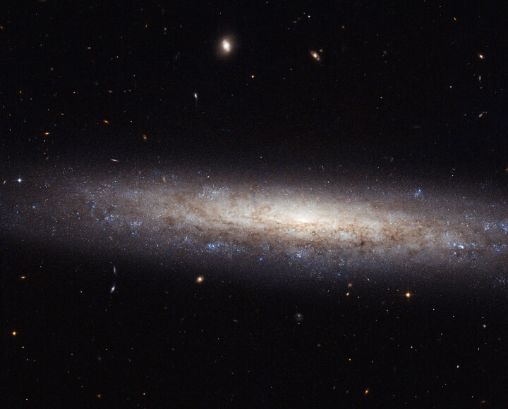 A dusty spiral in Virgo by ©NASA ESA